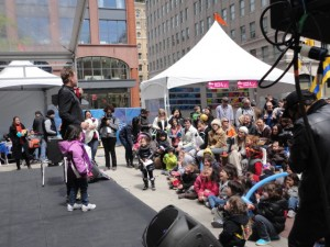The Amazing Max takes the mainstage at the Tribeca Family Fesitval performing a routine his family magic show.