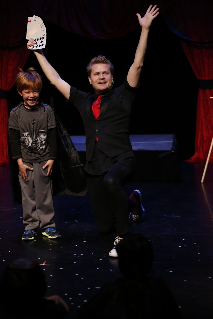 The Amazing Max and assistant performing a family friendly interactive magic show playing off Broadway in New York City.